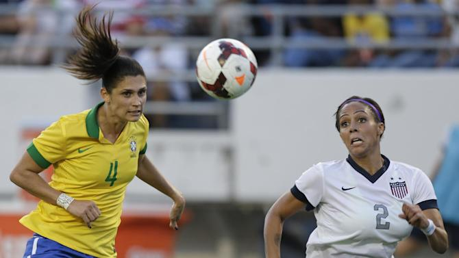Brazil defender Andreia (4) clears the ball away from U.S. forward Sydney Leroux (2) during the second half of an international friendly soccer match in Orlando, Fla., Sunday, Nov. 10, 2013. United States Women's national team defeated Brazil 4-1