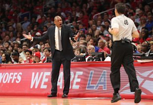 Doc Rivers complains to referee Scott Foster during Game 5. (Stephen Dunn/Getty Images)