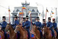 Russian cossacks wearing historic outfits ride horses during the start of their march from the Poklonnaya Gora Memorial Park in Moscow to Paris