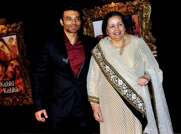 The late Indian Bollywood producer and director Yash Chopra's wife Pamela Chopra (R) and her son, film actor Uday Chopra pose on the red carpet at the premiere of the Hindi film 'Jab Tak Hai Jaan' in