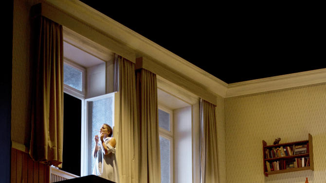 """In this Oct. 29, 2012 photo provided by the Opernhaus Frankfurt Christian Gerhaher in the role of Pelleas, bottom, and Christiane Karg as Melisande, top, perform during a dress rehearsal for the Claude Debussy's opera """"Pelleas et Melisande"""" at the opera in Frankfurt, central Germany. (AP Photo/Opernhaus Frankfurt, Monika Rittershaus) NO SALES - ONE TIME USE ONLY NO ARCHIVE"""