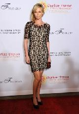 Charlize Theron arrives at REACH: 24 Portraits by Randall Slavin Benefitting The Charlize Theron Africa Outreach Project at The Annenberg Space for Photography in Los Angeles on October 12, 2011 -- Getty Images