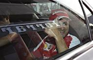 Ferrari Formula One driver Felipe Massa of Brazil gestures after leaving a promotional event at a Ferrari dealership in Singapore before the Singapore F1 Grand Prix September 18, 2013. REUTERS/Tim Chong