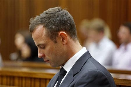 Pistorius sits in court during the fifth day of his trial for the murder in Pretoria