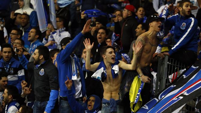 Porto's supporters react after the team's Europa League soccer match against Eintracht Frankfurt in Frankfurt