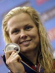 Germany's Britta Steffen celebrates on the podium after the women's 100-metre freestyle swimming event in the 31st European Swimming Championships in Debrecen. Steffen won the silver medal