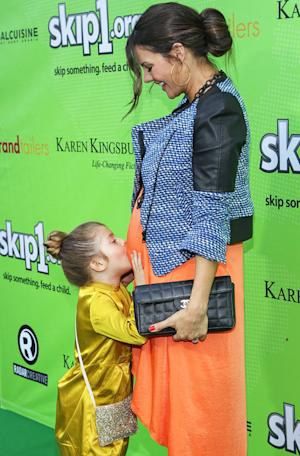 Ali Landry's Daughter Estela Kisses Her Baby Bump on Red Carpet