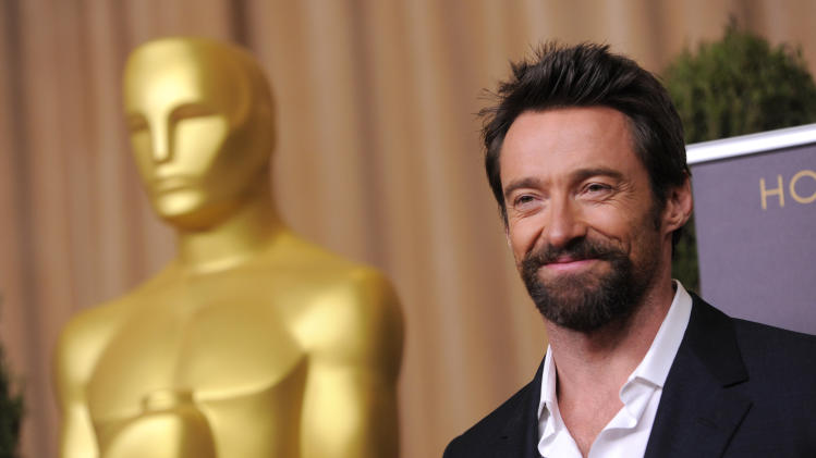 "Hugh Jackman, nominated for best actor in a leading role for ""Les Miserables,"" arrives at the 85th Academy Awards Nominees Luncheon at the Beverly Hilton Hotel on Monday, Feb. 4, 2013, in Beverly Hills, Calif. (Photo by Chris Pizzello/Invision/AP)"