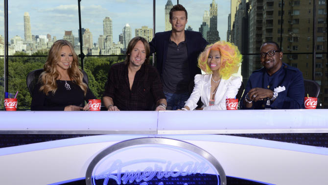 This photo provided by Fox, American Idol host Ryan Seacrest, center, poses with judges, from left, Mariah Carey, Keith Urban, Nicki Minaj and Randy Jackson, Sunday, Sept. 16, 2012 in New York. The Fox network officially announced the addition of Urban and Minaj on Sunday, confirming rumors surrounding them both just hours before the first round of auditions for next season was due to begin in New York. (AP Phioto/Fox, Michael Becker)