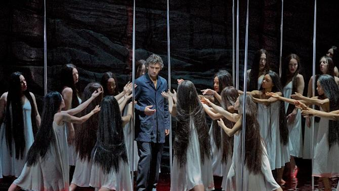 "In this photo provided by the Metropolitan Opera, Jonas Kaufmann rehearses the title character of Wagner's ""Parsifal,"" Feb. 8, 2013 in New York. Though traditionalists may object, this is a ""Parsifal"" to treasure, elevated to the highest musical level by the solemnity and sweep of Daniele Gatti's conducting and the dedication of a dream cast of singing actors, headed by tenor Jonas Kaufmann in the title role. (AP Photo/Metropolitan Opera, Ken Howard)"