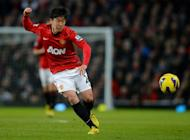 Manchester United midfielder Shinji Kagawa has a go at goal against Southampton at Old Trafford on January 30, 2013. Japan international Kagawa believes Robin van Persie can prove pivotal in the title race