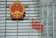 China's National Emblem and a reflection of the national flag outside the courthouse in Hefei. Gu Kailai -- the wife of disgraced Chinese politician Bo Xilai -- did not deny murdering a British man during her one-day trial that ended with no verdict in Hefei