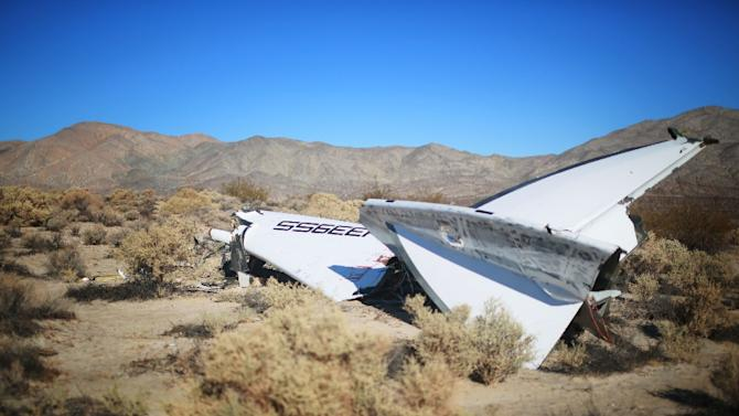 Debris from Virgin Galactic SpaceShipTwo sits in a desert field November 2, 2014 north of Mojave, California after crashing during a test flight