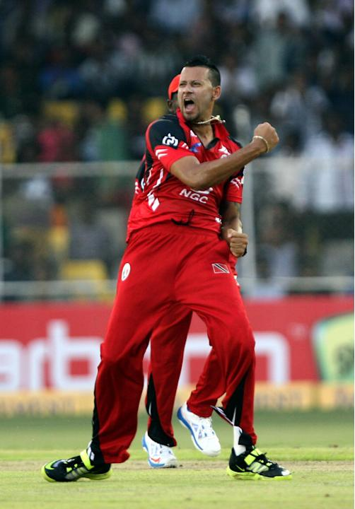 RR Emrit of Trinidad & Tobago celebrates the fall of H Davids' wicket during the CLT20 match between Titans and Trinidad & Tobago at Sardar Patel Stadium, Motera in Ahmedabad on Sept. 30, 2013. (P