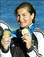 German kayaker Birgit Fischer show her two gold medals to photographers at the end of medals ceremony of the women's K2, 500 meters final, on Penrith Lake, west of Sydney, 01 October 2000, at the Sydney Olympic games. Birgit Fischer won 10 medals, 7 of them gold since Moscow Olympic Games (1980), 20 years of competition. AFP PHOTO/ THOMAS COEX