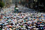 Supporters of the Islami Andolan Bangladesh pray in Dhaka, on March 29, 2013. Clashes in Bangladesh between police and supporters of the country's biggest Islamic party have left five dead during protests linked to ongoing war crimes trials, according to the police and local media
