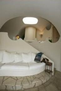 Seashell home undulates with Carmel landscape couch