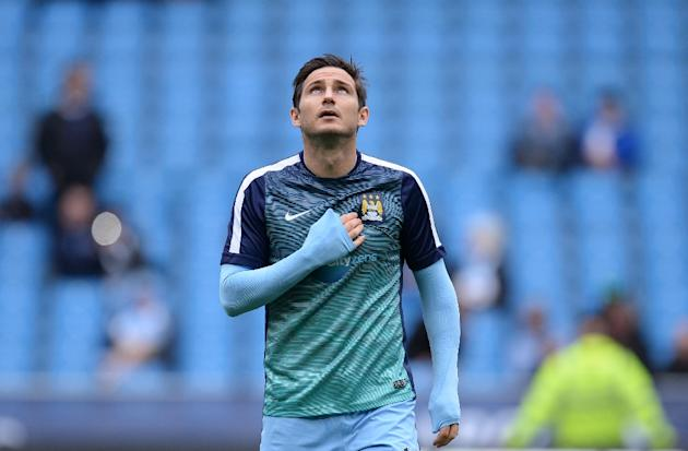 Manchester City's English midfielder Frank Lampard warms up on the pitch ahead of the English Premier League football match between Manchester City and Queens Park Rangers in Manchester, England,