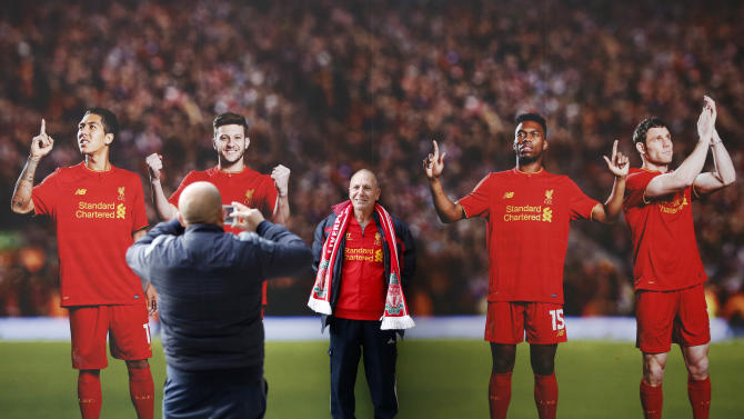 Liverpool fan has his photograph taken outside the ground before the match