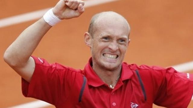 Tennis - Davydenko through to face Berdych in Barcelona