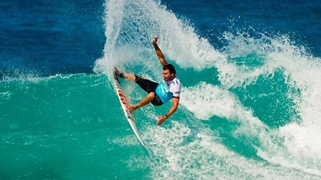 Surfing - Parkinson knocked out in opening heat