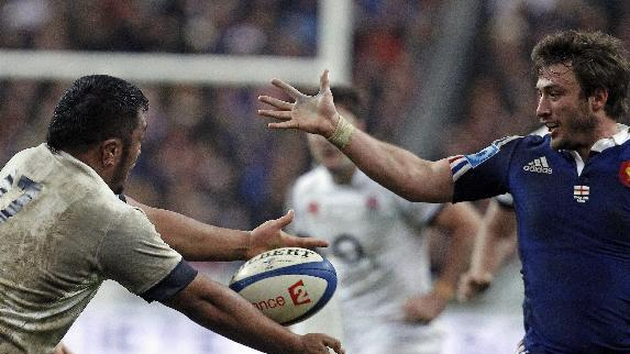 England's Mako Vunipola, left, and France's Maxime Medard, vie for the ball, during their Six Nations rugby union international match, at the Stade de France, in Saint Denis, outside Paris, Saturday, Feb 1, 2014. France defeated England 26-24