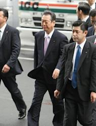Former Democratic Party of Japan leader Ichiro Ozawa (centre) arrives at the Tokyo District Court. Ozawa, one of the most powerful men in Japanese politics, has been found not guilty of a major funding scandal