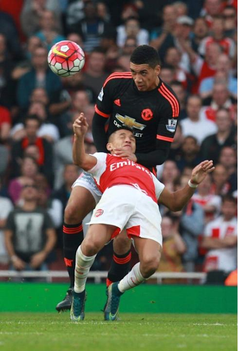 Manchester United's Chris Smalling (up) fights for the ball with Arsenal's Alexis Sanchez during their English Premier League match, at the Emirates Stadium in London, in October 2015