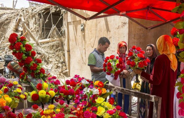 PISHAN, July 5, 2015 (Xinhua) -- A vendor sells artificial flowers at a bazaar in quake-hit Pishan County, northwest China's Xinjiang Uygur Autonomous Region, July 5, 2015. A 6.5-magnitude earthqu