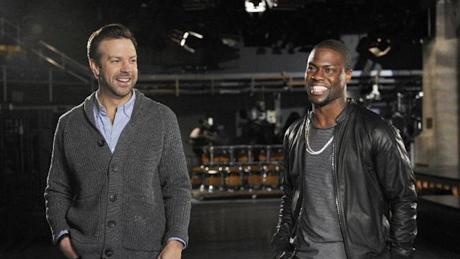 "This Feb. 26, 2013 photo released by NBC shows cast member Jason Sudeikis, left, and guest host Kevin Hart during rehearsals for ""saturday Night Live,"" in New York.  Hart will host the show on Saturday, March 2, with musical guest Macklemore & Ryan Lewis. (AP Photo/NBC, Dana Edelson)"