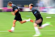 England's forward Wayne Rooney (R) runs during a training session at the Dombass Arena stadium in Donetsk on the eve of the team's Euro 2012 opening football match
