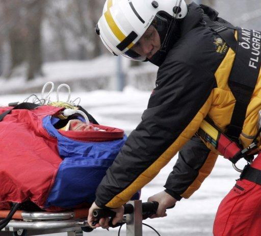 Grugger is rushed to hospital moments after the crash in Kitzbuehel in 2011