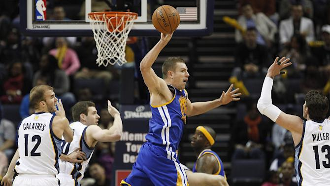Golden State forward David Lee (10) hands off the ball past Memphis defenders Nick Calathes (12), Jon Leuer, back, and Mike Miller (13) in the second half of an NBA basketball game Saturday, Dec. 7, 2013, in Memphis, Tenn. Golden State won 108-82