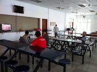 Residents at the Sungai Buloh centre for the beggars and homeless watch TV. ― Picture by Boo Su-Lyn