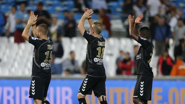Reims players salute their supporters after they defeated Olympique Marseille during their French Ligue 1 soccer match at the Velodrome stadium in Marseille