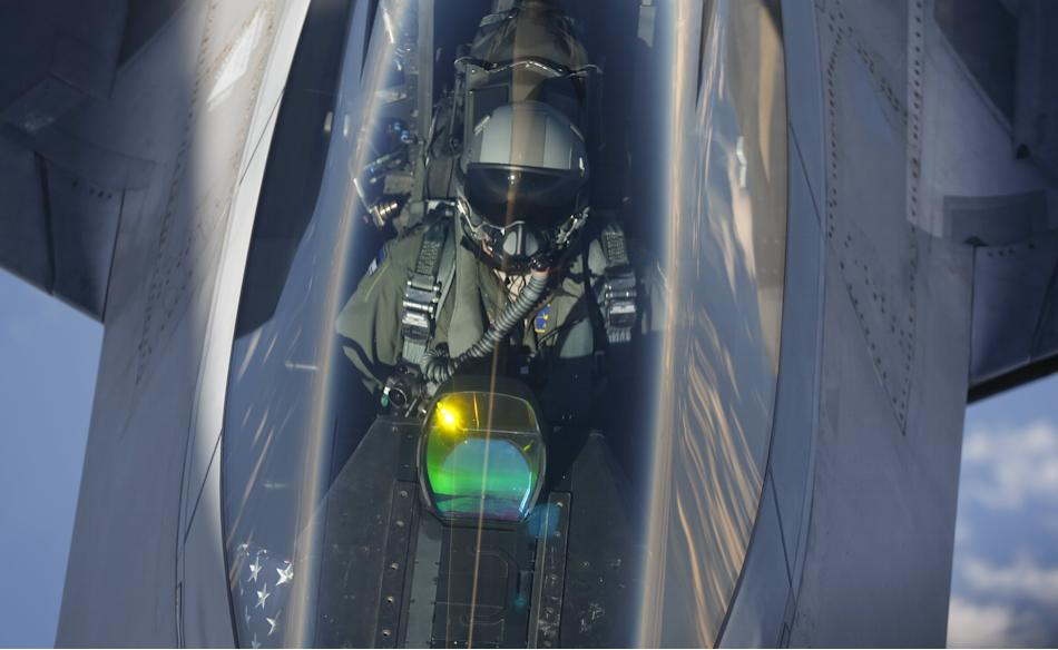 A F-22 Raptor fighter jet is being refuelled by a KC-135 Stratotanker over the Baltic Sea
