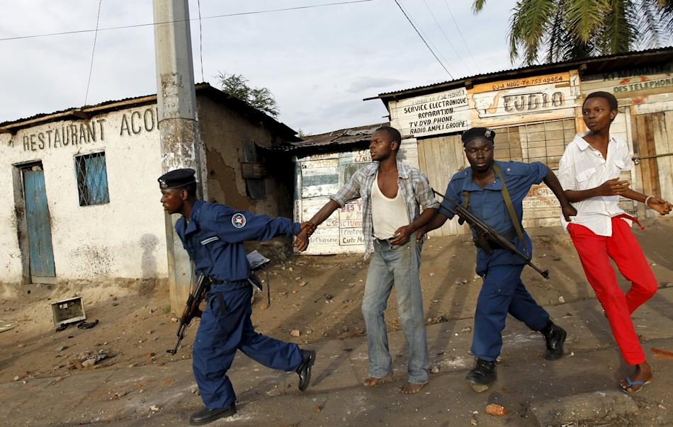 Riot police detain residents participating in street protests in Burundi's capital Bujumbura