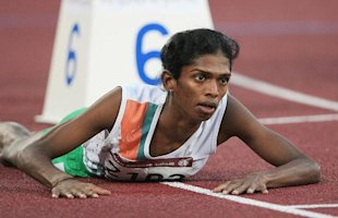 India's Santhi Soundarajan lies on the track after edging out Kazakhstan's Viktoriya Yalovtseva for second place in the women's 800m final on the second day of the athletics competition for the 15th Asian Games at Khalifa Stadium in Doha. Indian athlete Santhi Soundarajan, was stripped of her Asian Games silver medal for what was branded a failed gender test.