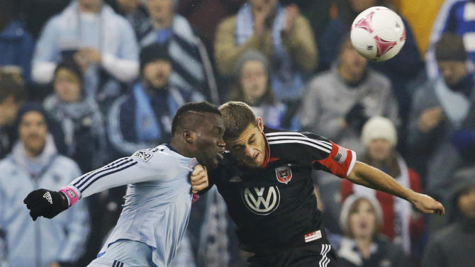 Sporting KC midfielder Peterson Joseph, left, and D.C. United defender Chris Korb (22) head the ball during the first half of an MLS soccer match in Kansas City, Kan., Friday, Oct. 18, 2013