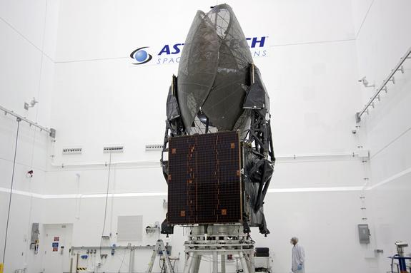 In the Astrotech payload processing facility in Titusville, Fla. near NASA's Kennedy Space Center, a Boeing technician checks out the Tracking and Data Relay Satellite, TDRS-K. This image was released Jan. 11, 2013.