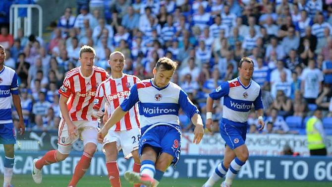 Reading's Adam Le Fondre, centre, scored from the penalty spot to rescue a point