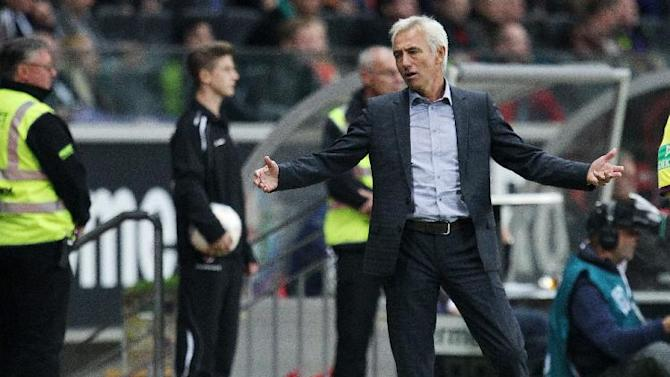 Hamburg head coach Bert van Marwijk reacts during a German soccer Bundesliga match between Eintracht Frankfurt and Hamburger SV in Frankfurt, Germany, Saturday, Sept. 28, 2013