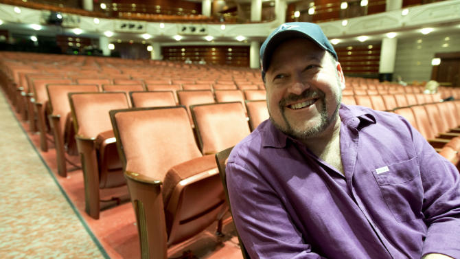 """In this March 29, 2013 photo, composer Frank Wildhorn sits inside a theater in West Palm Beach, Fla. Wildhorn first found success as a pop and R&B songwriter, penning Whitney Houston's ballad """"Where Do Broken Hearts Go.""""  He ruled Broadway in the late 1990s when he had three shows running simultaneously, a nearly four-year run for """"Jekyll and Hyde,"""" """"The Scarlett Pimpernel"""" and """"The Civil War,"""" which all were nominated for Tony Awards. Now, Wildhorn's eighth Broadway show, a revamped revival of """"Jekyll and Hyde,"""" opens on April 18. (AP Photo/J Pat Carter)"""