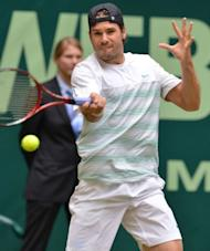 Germany's Tommy Haas returns a ball to his compatriot Philipp Kohlschreiber during their semi-final match of the ATP Gerry Weber Open tennis tournament in Halle, western Germany. Haas won 7-6 (7/5), 7-5