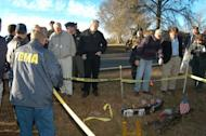 FEMA official surveys shuttle debris along with the Columbia Accident Investigation Board near Nacogdoches, Texas.