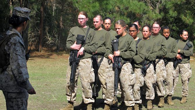 In this Feb. 21, 2013 photo, female recruits form up at the Marine Corps Training Depot on Parris Island, S.C. Brig Gen. Loretta Reynolds, the first female general in charge of Parris Island's basic training, says she is confident that women in the Corps will do well in combat, if need be. (AP Photo/Bruce Smith)