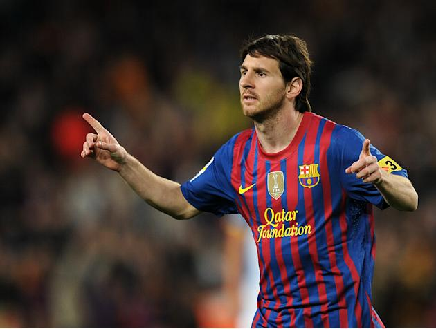 Barcelona's Argentinian forward Lionel Messi celebrates after scoring a goal during the Spanish league football match FC Barcelona vs RCD Espanyol on May 5, 2012 at the Camp Nou stadium in Barcelo
