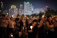 People take part in a candlelight vigil in Hong Kong held to mark the crackdown on the pro-democracy movement in Beijing's Tiananmen Square in 1989. Hong Kong held a candlelight vigil Monday to mark the 23rd anniversary of the Tiananmen Square crackdown, in stark contrast to mainland China where activists said hundreds of people were detained