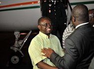 Interim president of Guinea-Bissau Raimundo Pereira is greeted by an Ivory Coast official upon his arrival at the Felix Houphouet Boigny airport in Abidjan, April 27. Guinea-Bissau's coup leaders released the country's ousted prime minister and interim president after more than two weeks of captivity, allowing the former leaders to travel to Ivory Coast