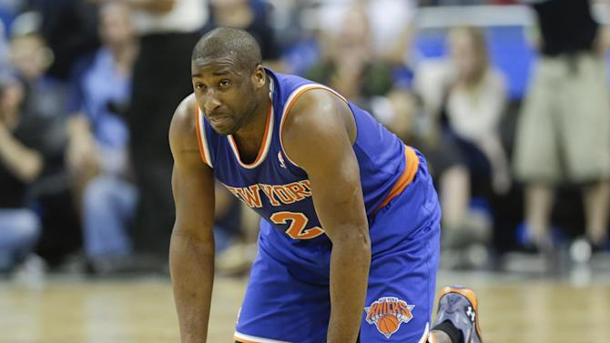 New York Knicks' Raymond Felton kneels on the court after he was injured in the second half of an NBA basketball game against the Orlando Magic in Orlando, Fla., Monday, Dec. 23, 2013. Felton left the game and did not return but New York won 103-98